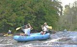 Rafters go over rapids on Wolf River.