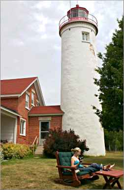 A guest relaxes at Jacobsville Lighthouse.
