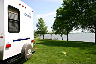 A camper sits by a Kandiyohi County lake.