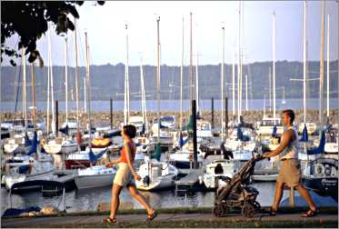 People stroll by Lake City marina.