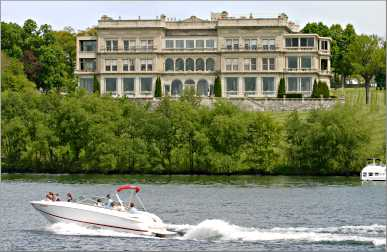 A speedboat cruises past Lake Geneva's Stone Manor.
