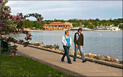 People walking around Geneva Lake.