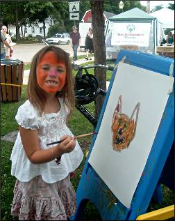 A child paints at Lake Mills Arts Festival.