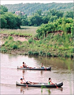 Canoeists paddle the Root River near Lanesboro.