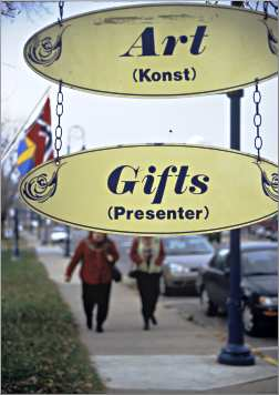 English-Swedish shop signs in Lindstrom.