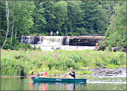 Canoeing past Lower Falls.