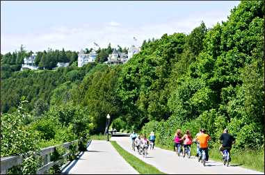 Bicyclists under Mackinac's West Bluff.