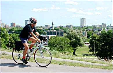 A bicyclist in Milwaukee's Reservoir Park.