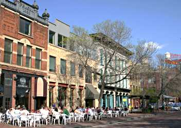 On Main Street, diners eat outside on a spring day.