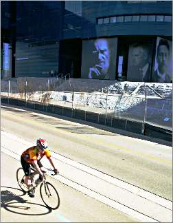 A bicyclist rides by the Guthrie Theater.