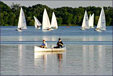 Sailboats and canoe on Lake Harriet.