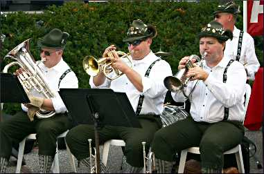 A German brass band plays.