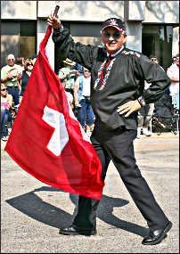 Swiss flag-throwing during a parade.