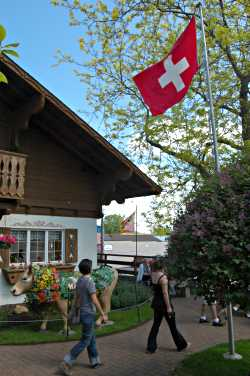 The Swiss flag flies over the Maple Leaf imports shop.