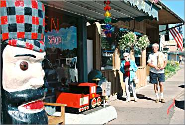 Shoppers stroll down the street in Nisswa.