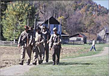 Civil War re-enactors march at Norskedalen.