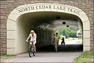 A bicyclist on the North Cedar Lake Trail.