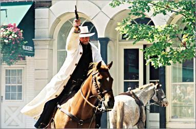 A horseman fires during Northfield's Jesse James festival.