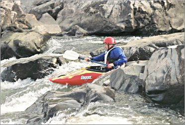 A kayaker fights his way through Missouri shut-ins.