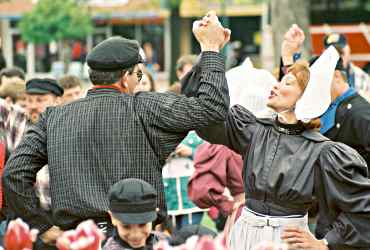 Costumed folk dancers twirl during Tulip Time in Pella, Iowa