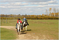 Riding horses around Pine River, Minn.