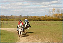 Riding horses around Pine River, Minn.