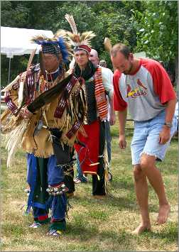 A tourist dances at a Pipestone powwow.