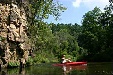 A kayaker on the Kinnickinnic River