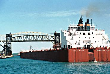 The Mesabi Miner heads out of Lake Superior through the Soo