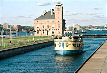 A tour boat goes through the Soo Locks.