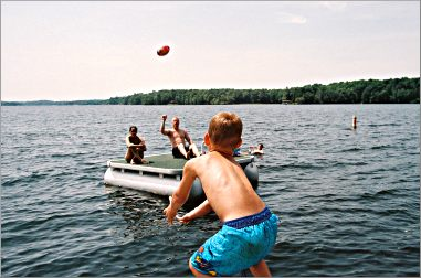 Playing ball on the lake.