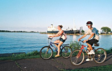 Bicyclists pass the S.S. Meteor on Superior's Osaugie Trail.