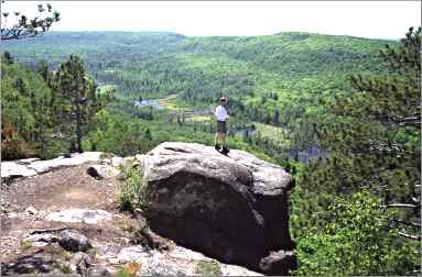 A hiker enjoys the view from Mount Trudee on the Superior Hi