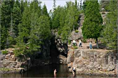 Swimmers at the mouth of the Temperance River.