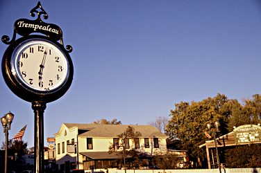 A vintage clock stands along Trempealeau's riverfront.