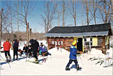 Skiers at Whitecap Mountain's wine hut.