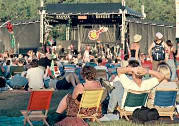 Fans listen to music at the Winnipeg Folk Festival.